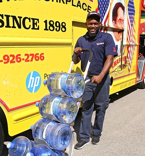 W.B. Mason Driver Delivering Water