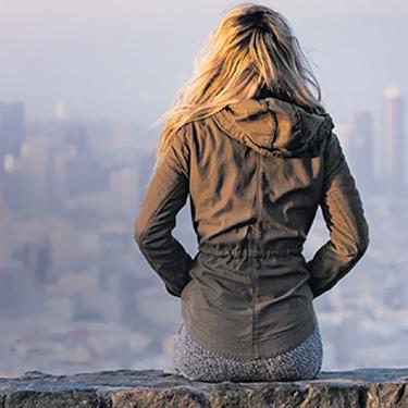 Girl Gazing at City
